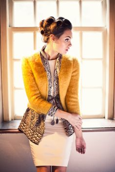 Great colors and classy silhouette. Love the sixties vibe of the makeup and hair as well.