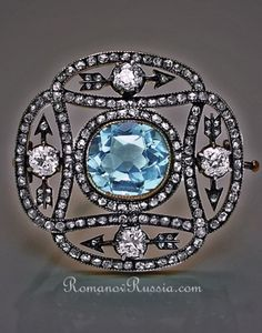 An antique eternity brooch, by Carl Fabergé, circa 1899-1908.  Designed as an openwork plaque, the central collet-set aquamarine surrounded by four arrows forming a circle, each arrow highlighted with an old brilliant-cut diamond, the frame shaped as two interlaced loops set with rose-cut diamonds. The circle of arrows within the interlaced frame symbolises eternity. #Faberge #antique #brooch