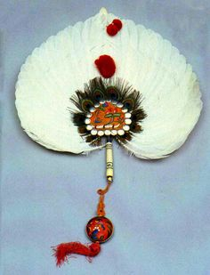 Imperial feather fan used at Qing Dynasty Court by the empresses and concubines of the emperor in the collection of the Forbidden City Palace Museum.