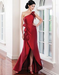 Sarah Danielle style 5218  Silk dupion one shoulder accented with bows with ruched cummerbund, bows accent hip tulip skirt- high low.