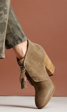 Soft suede lace up bootie with tassel detail on laces, rounded toe and a stacked heel. #streetstyle