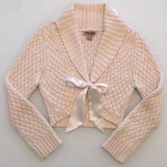 """Adorable Cropped Sweater Adorable cropped sweater. Size Large. Beautiful cream color with a cream satin bow. GUC. Measures about 16"""" from top of shoulder to side of bottom and about 17"""" from armpit to armpit. No trades. Bundle to save! Tops Crop Tops"""