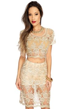 Dress to impress in this look youll absolutely love! Slip into this sexy two piece outfit and captivate everyone attention. Youll sure get compliments from ear to ear. It features floral tinsel embroidered, round neckline, short sleeves, cropped, scallop trim, sheer top, with matching elastic-band pencil skirt, and fitted. 100% Polyester. *Bandeau top not included! *Sizes run one whole size smaller.