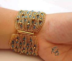 This bracelet made of golden Czech beads is very soft, smooth and light. It wraps the wrist so softly and pleasantly. Sparkling faceted beads add fascinating charm. It will be you favorite.    Length - 18 cm (7.09)  width - 4.5 cm (1.77)  ***  Ready for shipment.  ***  I am a proud member of the Etsy BeadWeavers Team. Search EBW TEAM for more beautiful beadwoven creations or visit our blog for links to all members shops: http://etsy-beadweavers.blogspot.com