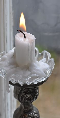 White candle drippings, mostly collected upon a charming bobeche ~ the pewter embossed candlestick completes this picture of pure romance!