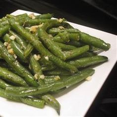 Buttery Garlic Green Beans These are delicious and so very simple. I used the frozen green beans from Trader Joes, a great staple to have in your freezer. They only took about 3 minutes in the boiling water.