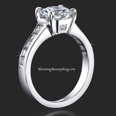 Round Diamond Engagement Ring with channel set Princess cut diamonds in the band and a #PeekabooDiamond on each side of the head from BloomingBeautyRing.com