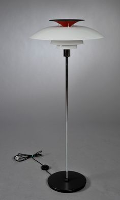 Poul Henningsen 1897-1967. PH 80-floor lamp with shades of acrylic and top of the red / black plastic, stand-plated metal mounted on black base. Produced by Louis Poulsen