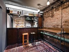 Interior metallic framework makes-up the fabric of this delectable drinking hole in Poland via Frameweb.com