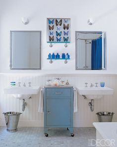Hampton's home of Sarah Jessica Parker and Matthew Broderick.  Love the wall mounted sinks, & vintage storage cabinet.