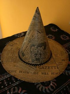 Newspaper Witch Hat~I'm thinking this could be made with a cardboard rim and paper cone, maybe?