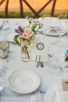 floral centerpiece in jar with table card and place settings - warm, sunny, Sonoma California vineyard wedding photo by California wedding photographers EP Love