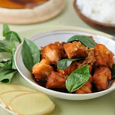 Fried salmon cubes cooked in a clay pot with ginger, garlic, Thai ...