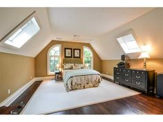 attic turned into master bedroom. looove that big window and all