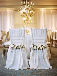 Wedding reception chairs flowers white cream lights candles decoration decor