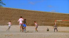 Playing soccer on sand