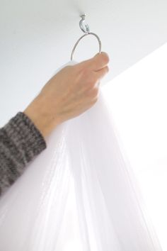 """How to Hang a Mosquito Net Bed Canopy. If you love a laid-back, romantic, ethereal bedroom design, we've got a how-to for you. Find out how to put together this simple """"Out of Africa"""" look today.  #interiors #homedecor"""