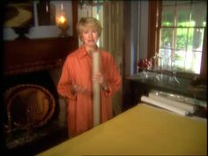 Martha Stewart rolls up a tablecloth with a cardboard tube and tissue paper as clever way to keep the linens wrinkle-free for future use.