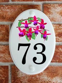 A range of pottery style house plaques feature prints of original artwork from our own sign artists. Hand cast in cultured marble these number plates are weatherproof outdoors. House Plaques, House Number Plaque, House Numbers, Floral Motif, Original Artwork, Decorative Plates, Pottery, Prints, Home Decor