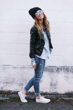 Wear a black leather biker jacket and blue skinny jeans for a Sunday lunch with friends. For footwear go down the casual route with white canvas low top sneakers.   Shop this look on Lookastic: https://lookastic.com/women/looks/biker-jacket-denim-shirt-skinny-jeans-low-top-sneakers-beanie-sunglasses/4297   — Black Beanie  — Light Blue Denim Shirt  — Black Leather Biker Jacket  — Blue Skinny Jeans  — White Canvas Low Top Sneakers  — Green Sunglasses