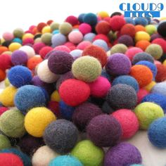 What a statement on your floor!! beautifully handcrafted circular felt ball rug, in a rainbow of colours. same size felt balls as the trivet and placemats.  Handmade in nepal these stunning designer rugs are perfect for any room in the house. with the flair and creativity of the design these heavy duty rugs would last a lifetime and are sure to make a statement. each ball is 100% soft new zealand wool, is felted and then hand stitched together.