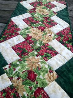 Christmas Table Runner-maybe I'll change out the center squares for embroidered squares.