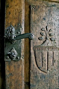 beautiful old carved oak door with iron hardware