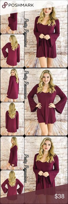 """NWT Long Bell Sleeve Wine Tunic Mini Dress NWT Long Bell Sleeve Wine Tunic Mini Dress  Available in sizes S (M & L sold out) * Small will fit a S/M fine as well * Measurements taken from a small  Length: 31"""" Bust: 38"""" Waist: 42""""  Rayon/Spandex  Made in the USA  Features  • long bell sleeves  • stunning deep wine color • rounded plunging v-neckline  • úber soft material (seriously, you'll want to live in this) • relaxed fit  Bundle discounts available  No pp or trades  Item # 1/301310380WPB…"""