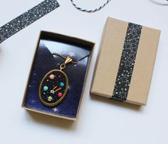 Some planets and stars has embroidered by hand onto a black cotton fabric with DMC mouline %100 cotton threads. Details:  -The pendant ball chain