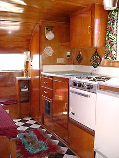 What a sweet little kitchen in this vintage trailer!