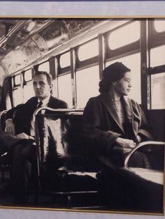 A famous picture of Rosa Parks on an integrated bus.  When Rosa refused to give her seat up on the bus for a white man she became a role to many and nearly changed the future.