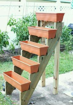 Ingenious Idea: The planters fixed on this ladder like structure will bring you more space and also save your plants from crawling pests and insects. A space saver for small patios