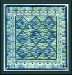 "Seaside Blues is a beachy design in the American Quilt Collection by Laura J. Perin Designs. The stitch count is 160 x 166 with a design size of 9"" x 9.5"". This pattern would also be fun to stitch in other colors such as bright red, yellow and blue, or soft pastels for a dreamy springtime feel.  Supplies required:  15"" (6"" included for finishing) of 18-count Eggshell Mono Canvas (9281-270)   Caron Collection Watercolours: 207   DMC Size 5 Pearl Cotton: 597 x 2"