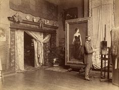 "Photograph of John Singer Sargent in his studio with his painting ""Madame X""."