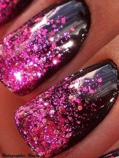 Pink glitter manicure over black polish. Nail art