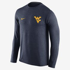 REPRESENT YOUR TEAM The long-sleeve Nike College Dri-FIT Touch (West Virginia) Men's Training Shirt helps keep you comfortable and moving freely during your workout with lightweight Dri-FIT fabric and underarm insets. Benefits Dri-FIT fabric helps keep you dry and comfortable Underarm insets for wider range of motion Flat seams feel smooth against your skin Product Details Crew neck with interior taping Fabric: Dri-FIT 100% polyester Machine wash Imported
