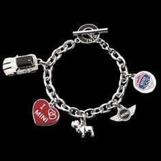 "MINI Anniversary Bracelet - 7 3/4"" MINI Cooper Charm Bracelet - 10 year Anniversary Charm,  3D  Mini Cooper Wings Logo, High Polished 3D Bulldog Charm, Enamel I ""heart"" Mini Charm, and 3D Enamel Mini Cooper Car - Cable link Chain with Enameled Toggle Closure. Imported. http://www.shopminiusa.com/PRODUCT/1157/MINI-ANNIVERSARY-BRACELET/?CenterId=21188"