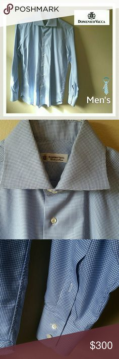 """NWOT! Men's Domenico Vacca Hndstooth Dress Shirt Never Worn ever! I did dry clean it though because it's been in the closet for a bit. It's perfect. In every way. These are luxury for Men for sure! This dress shirt is high end. It was made beautifully. It is comprised of a ton of time white hounds tooth like shapes. It's baby blue and white. Flawless!!! It's 41/16. Measures 26"""" arm. 30 1/2 shoulder to bottom hem. Get this for your hard working man! He'll love it. It's so chic and…"""