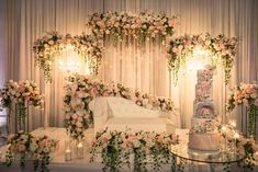 Bathed in the glow of candlelight on the pretty pink petals to the lavish long leaves, this picture-esque reception stage is absolutely entrancing! Vintage Wedding Backdrop, Wedding Backdrop Design, Desi Wedding Decor, Wedding Hall Decorations, Wedding Stage Design, Wedding Reception Backdrop, Backdrop Decorations, Wedding Mandap, Wedding Receptions