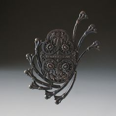Tamara Grüner Brooch: Hydra, 2011; Historical metal pieces - blackened, silver, steel; 9,0 x 8,1 x 0,9 cm