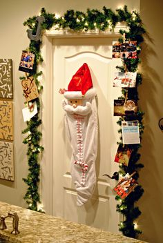 Christmas card display - garland around the door - I like the Advent Santa in the middle! - Just the Jensen Family: DIY Garland Christmas Card Holder