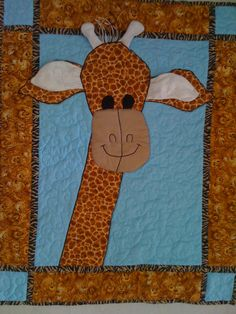 Quilting in Amsterdam: Free pattern: Giraffe baby quilt with bells in horns and rustling ears.