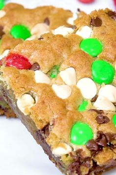 Christmas Cookie Bars loaded with M&M'S, chocolate chips and white chocolate chips. christmassnacks : Christmas Cookie Bars loaded with M&M'S, chocolate chips and white chocolate chips. Holiday Desserts, Holiday Cookies, Holiday Baking, Holiday Recipes, Christmas Cookie Recipes, Holiday Bars, Cookie Desserts, Christmas Snacks, Christmas Cooking