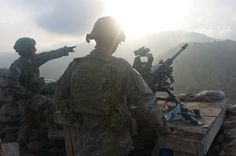 AKTIKA PROVINCE, Afghanistan -  Pvt. Seth Burke Thompson of Miami, Fl., and Spc. Wade Whiting of Blackfoot, Idaho - both 2nd Squad, 3rd Platoon, Company C, 3rd Battalion, 66th Armor Regiment, 172nd Infantry Brigade - man one of the 50 calibre machine guns on Observation Post 1 above Forward Operating Base Tillman as the sun rises on the tenth anniversary of 9/11. (U.S. Army photo by Spc. Ken Scar, 7th MPAD)