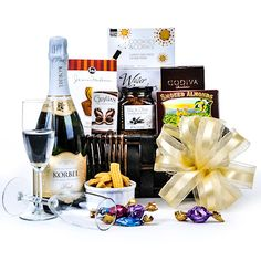The Champagne Elegance Basket features a beautiful array of products perfect for a special evening or impressive gift. Thoughtfully planned and elegantly packaged this basket is Champagne Gift Baskets, Dom Perignon, Gourmet Gift Baskets, Bubbles, Treats, Gifts, Food, Cakes, Gift Ideas