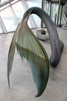 Amazing merman sculpture by artist Cameron Stalheim (photos are from his site and belong to him, not me).  Media is Plastic, Foam, Steel, & Acrylic.