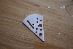paper snowflakes with a hole punch- great activity for building muscles for fine motor activities