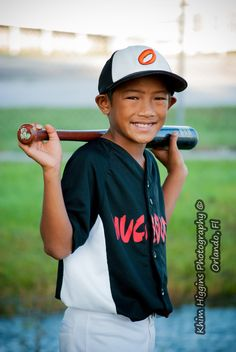 A classic baseball pose by Khim Higgins Photography, Orlando, Fl