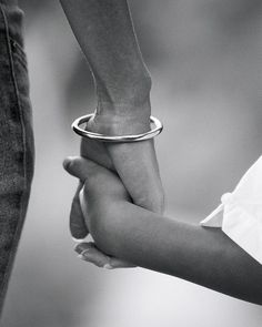 when a child takes your hand. smooth skinned little hand in your hand ploughed by life
