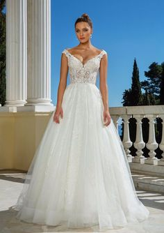Romance is created within this illusion bodice ball gown. Tonal beading and Venice lace adorn the dress. With a Chantilly lace underlay, this look is both sexy and beautiful.